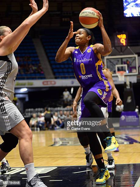 Alana Beard of the Los Angeles Sparks drives to the basket against the San Antonio Stars on August 2 2015 at the Freeman Coliseum in San Antonio...