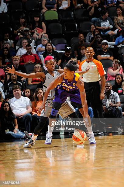Alana Beard of the Los Angeles Sparks handles the ball against Danielle Robinson of the San Antonio Stars at the ATT Center on August 10 2014 in San...