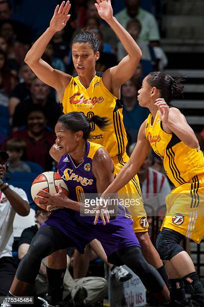 Alana Beard of the Los Angeles Sparks posts up against Nicole Powell of the Tulsa Shock during the WNBA game on August 2 2013 at the BOK Center in...