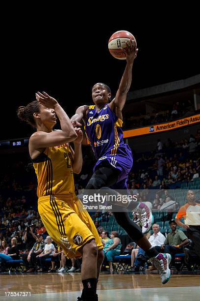 Alana Beard of the Los Angeles Sparks shoots against Nicole Powell of the Tulsa Shock during the WNBA game on August 2 2013 at the BOK Center in...