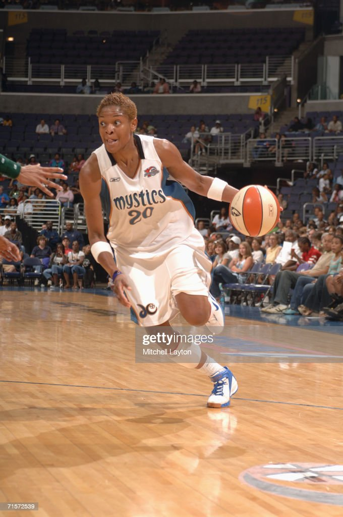 Alana Beard #20 of the Washington Mystics drives during a game against the Seattle Storm at MCI Center on July 23, 2006 in Washington, D.C. The Storm won 73-71.