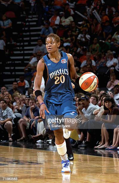 Alana Beard of the Washington Mystics moves the ball up court during a game against the San Antonio Silver Stars at ATT Center on July 21 2006 in San...