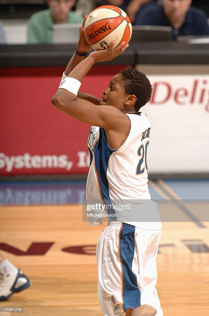 Alana Beard #20 of the Washington Mystics shoots during a game against the Indiana Fever at MCI Center on June 27, 2006 in Washington, D.C. The Fever won 74-67.