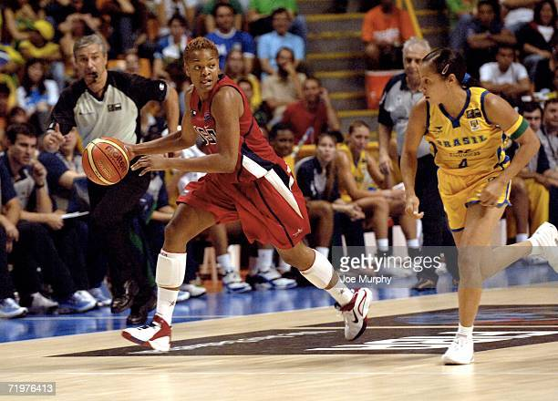 Alana Beard of USA drives past Adrianinha Adriana Pint of Brazil during the bronze medal game between USA and Brazil during the 2006 FIBA World...