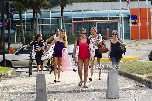 Alana Blanchard of Hawaii and Pauline Ado of France arrive at the Billabong Rio Pro at Barra da Tijuca on May 12 2011 in Rio de Janeiro Brazil