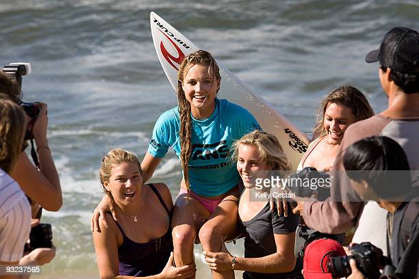 Alana Blanchard of Hawaii celebrates with friends Coco Ho and Leila Hurst after winning the Vans Hawaiian Pro title on November 19 2009 in Haleiwa...