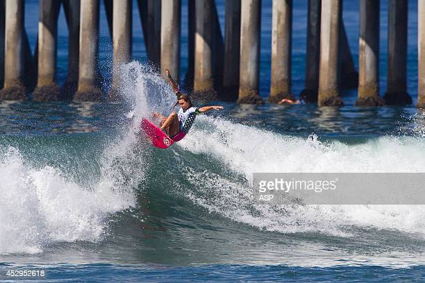 Alana Blanchard of Hawaii surfs during Round 2 of the Vans US Open of Surfingon July 30 2014 in Huntington Beach California