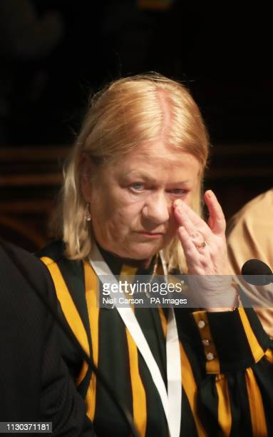 Alana Burke who was injured on Bloody Sunday reacts during the press conference at the Guildhall in Londonderry Northern Ireland after the...