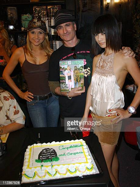 Alana Curry Robert Steven Rhine and Bai Ling celebrate the release of the premiere issue of 'Girls Corpses' with a cake and signing