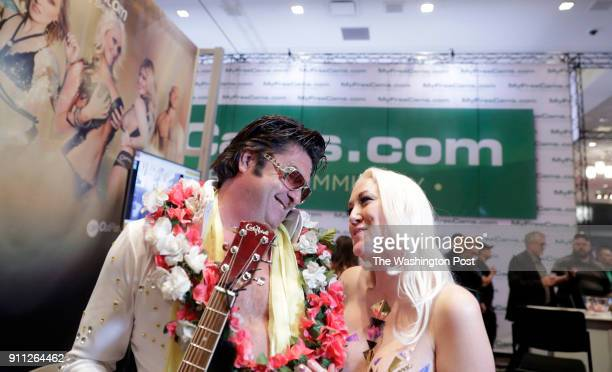 Alana Evans talks with an Elvis impersonator on the trade show floor during the AVN Adult Entertainment Expo at the Hard Rock Hotel Casino on Jan 25...
