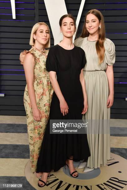 Alana Haim Danielle Haim and Este Haim attend the 2019 Vanity Fair Oscar Party hosted by Radhika Jones at Wallis Annenberg Center for the Performing...