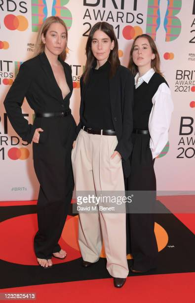 Alana Haim, Danielle Haim and Este Haim of HAIM arrive at The BRIT Awards 2021 at The O2 Arena on May 11, 2021 in London, England.