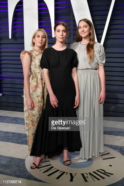 Alana Haim Danielle Haim and Este Haim of Haim attend the 2019 Vanity Fair Oscar Party hosted by Radhika Jones at Wallis Annenberg Center for the...