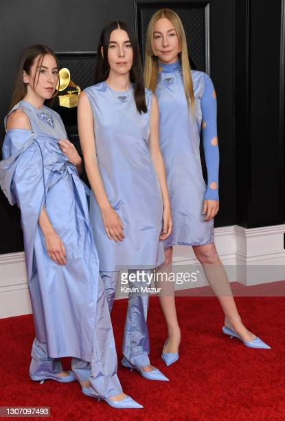 Alana Haim, Danielle Haim and Este Haim of HAIM attend the 63rd Annual GRAMMY Awards at Los Angeles Convention Center on March 14, 2021 in Los...