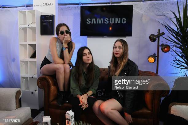 Alana Haim Danielle Haim and Este Haim of the band HAIM at the Samsung Galaxy Artist Lounge at Lollapalooza on August 3 2013 in Chicago City