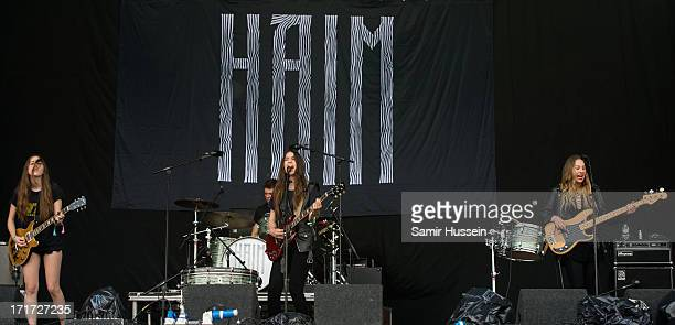 Alana Haim Danielle Haim and Este Haim perform on the Pyramid Stage at the Glastonbury Festival of Contemporary Performing Arts at Worthy Farm Pilton...
