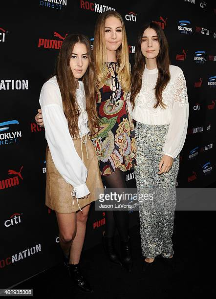 Alana Haim Este Haim and Danielle Haim of the band Haim attend the Roc Nation Grammy brunch on February 7 2015 in Beverly Hills California