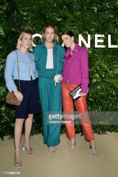 Alana Haim Este Haim and Danielle Haim wearing CHANEL attend Chanel Dinner Celebrating Gabrielle Chanel Essence With Margot Robbie on September 12...