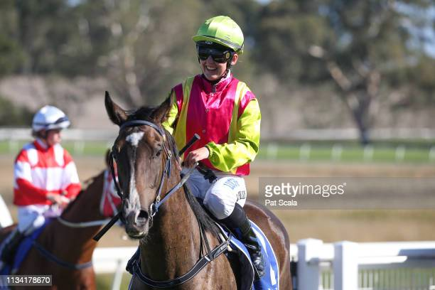 Alana Kelly returns to the mounting yard on Dr Dee Dee after winning the Taylor Motors BM58 Handicap at Hamilton Racecourse on April 01 2019 in...