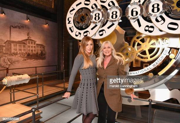 Alana Netzer and Elvira Netzer visit the IWC booth during the Maison's launch of its Jubilee Collection at the Salon International de la Haute...