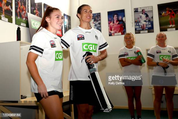Alana Porter of the Magpies is presented her guernsey by Ash Brazill of the Magpies during the round one AFLW match between the Collingwood Magpies...