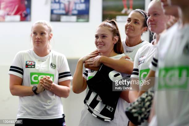Alana Porter of the Magpies is presented with her guernsey by Ash Brazill of the Magpies prior to the round one AFLW match between the Collingwood...