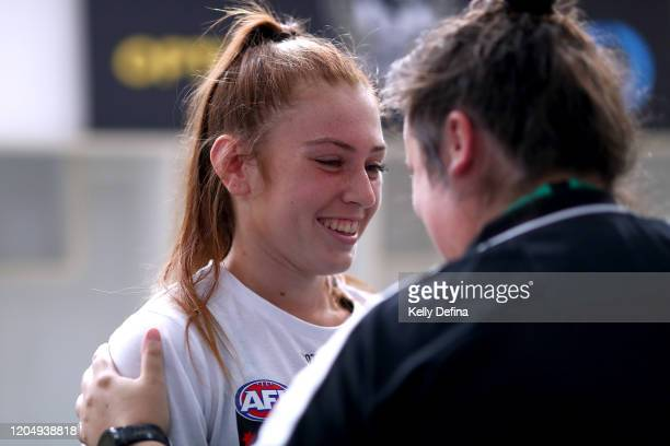 Alana Porter of the Magpies is presented with her guernsey during the round one AFLW match between the Collingwood Magpies and the West Coast Eagles...