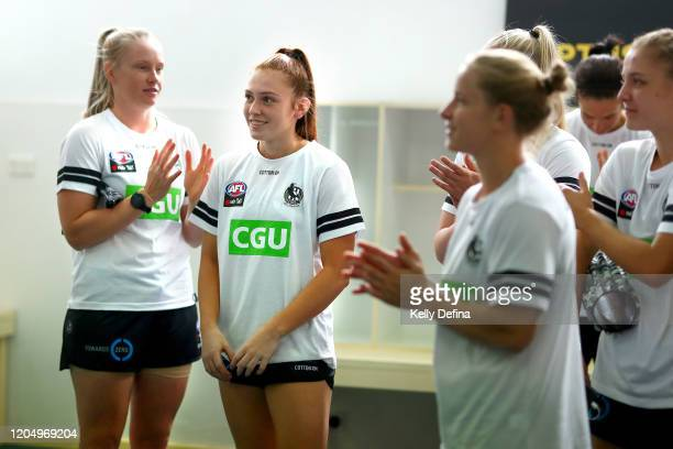 Alana Porter of the Magpies reacts while being presented with her guernsey during the round one AFLW match between the Collingwood Magpies and the...