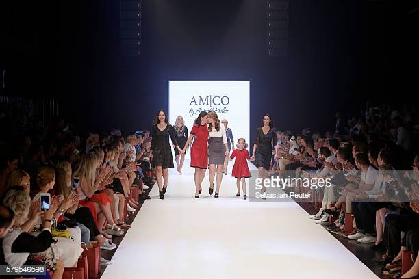 Alana Siegel, Katrin Wrobel, Annett Moeller, Louisa Wrobel and Dagmar Siegel acknowledge the applause of the audience on the runway for AMCO by...