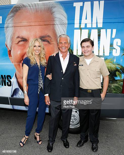 Alana Stewart George Hamilton and George Thomas Hamilton pose for a photo as E sends the Tan Man's Van off in style at the Farmers Market in Los...
