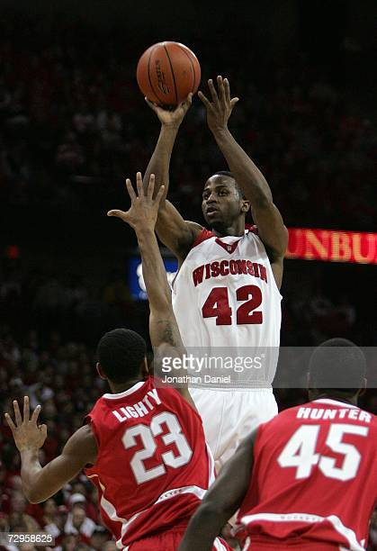 Alando Tucker of the Wisconsin Badgers attempts a shot against David Lighty and Othello Hunter of the Ohio State Buckeyes during their Big Ten...