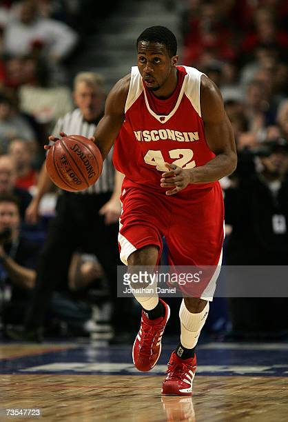Alando Tucker of the Wisconsin Badgers brings the ball up court against the Ohio State Buckeyes during the Final of the Big Ten Men's Basketball...
