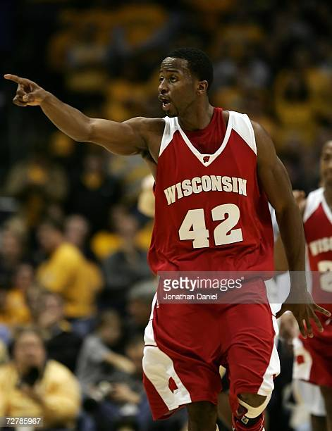 Alando Tucker of the Wisconsin Badgers celebrates in the final minute of Wisconsin's 7066 win against the Marquette Golden Eagles December 9 2006 at...