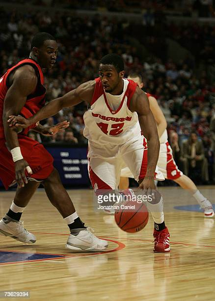Alando Tucker of the Wisconsin Badgers drives against Gaston Essengue of the UNLV Runnin' Rebels during the second round of the NCAA Men's Basketball...