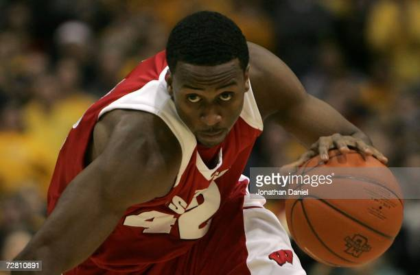 Alando Tucker of the Wisconsin Badgers drives against the Marquette Golden Eagles December 9 2006 at the Bradley Center in Milwaukee Wisconsin...