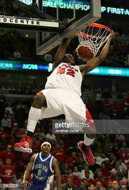Alando Tucker of the Wisconsin Badgers dunks against the Texas AM Corpus Christi Islanders during the first round of the NCAA Men's Basketball...
