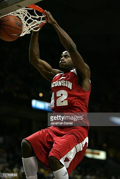 Alando Tucker of the Wisconsin Badgers dunks in the second half against the Marquette Golden Eagles December 9 2006 at the Bradley Center in...