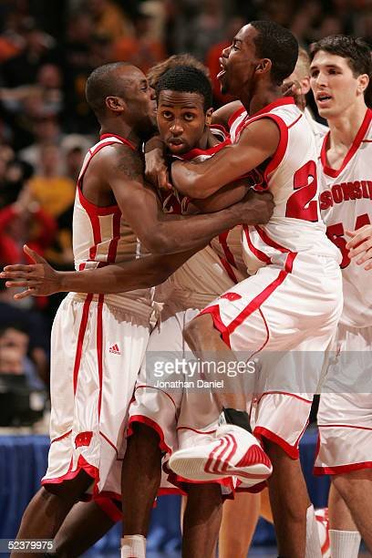 Alando Tucker of the Wisconsin Badgers is swarmed by teammate including Kammron Taylor after Tucker hit a gamewinning 3pointer at the buzzer tp...