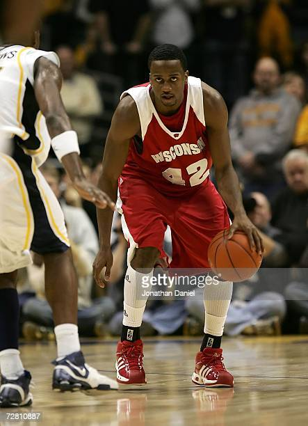 Alando Tucker of the Wisconsin Badgers moves the ball against the Marquette Golden Eagles December 9 2006 at the Bradley Center in Milwaukee...