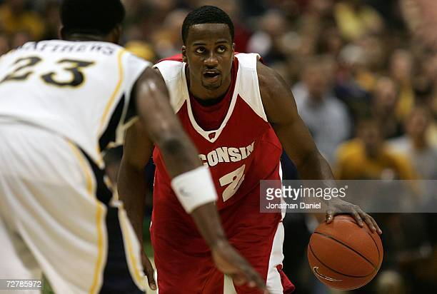 Alando Tucker of the Wisconsin Badgers runs the offense against Wesley Matthews of the Marquette Golden Eagles December 9 2006 at the Bradley Center...