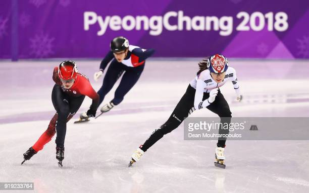 Alang Kim of Korea Kim Boutin of Canada Veronique Pierron of France compete during the Short Track Speed Skating Ladies' 1500m heats on day eight of...