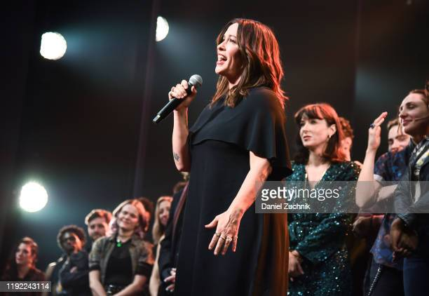 Alanis Morissette and cast pose during the curtain call of the opening night of the broadway show Jagged Little Pill at Broadhurst Theatre on...