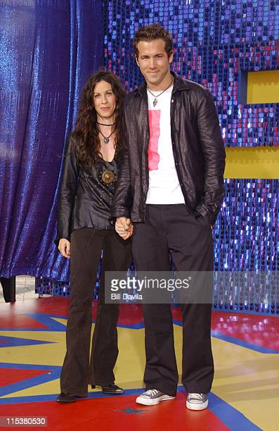 Alanis Morissette and Ryan Reynolds during 2003 MTV Movie Awards Arrivals at The Shrine Auditorium in Los Angeles California United States