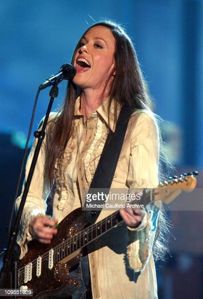 Alanis Morissette performs during a taping for American Bandstand's 50thA Celebration at the Pasadena Civic Auditorium Sunday April 21 2002 The show...