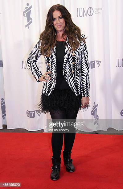 Alanis Morissette poses in the press room at the 2015 Juno Awards at FirstOntario Centre on March 15 2015 in Hamilton Canada
