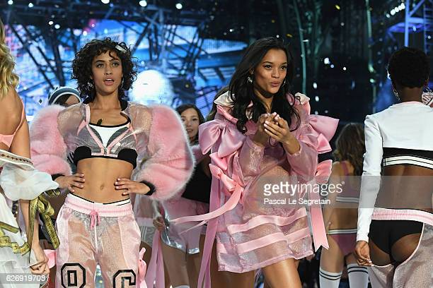 Alanna Arrington and Lamenka Fox walks the runway at the Victoria's Secret Fashion Show on November 30 2016 in Paris France