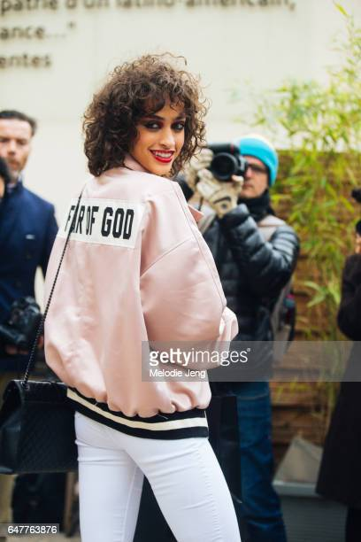 Alanna Arrington in a Fear of God pink jacket outside the Vanessa Seward show on March 3 2017 in Paris France