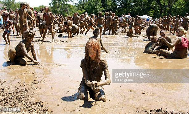 Alanna Gleason age 9 of Highland Michigan plays in a giant lake of mud at the 25th annual 'Mud Day' July 10 2012 in Westland Michigan The event which...