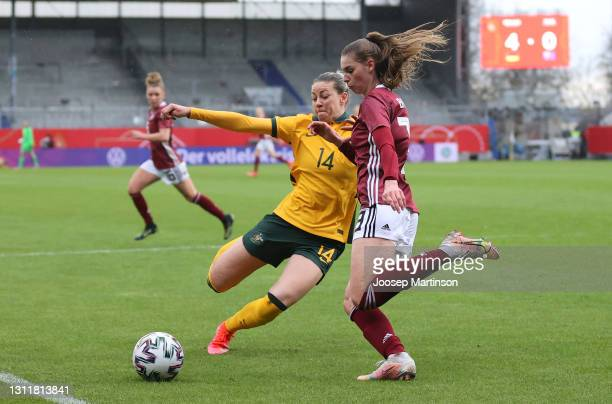 Alanna Kennedy of Australia and Jule Brand of Germany battle for the ball during the Women's International Friendly match between Germany and...