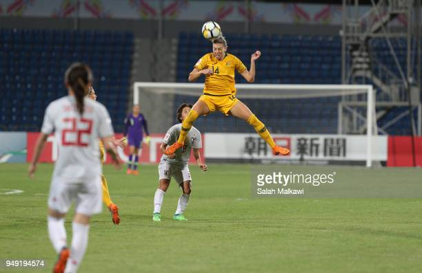Alanna Kennedy of Australia and Mana Iwabuchi of Japan challenge for the ball during the AFC Women's Asian Cup final between Japan and Australia at...